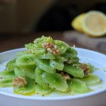 Celtuce salad with lemon and walnuts